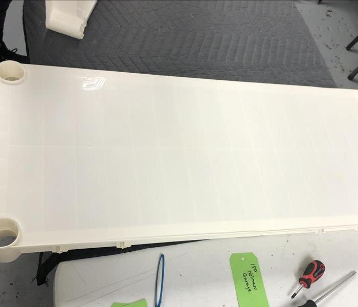 Image of the white plastic shelf a